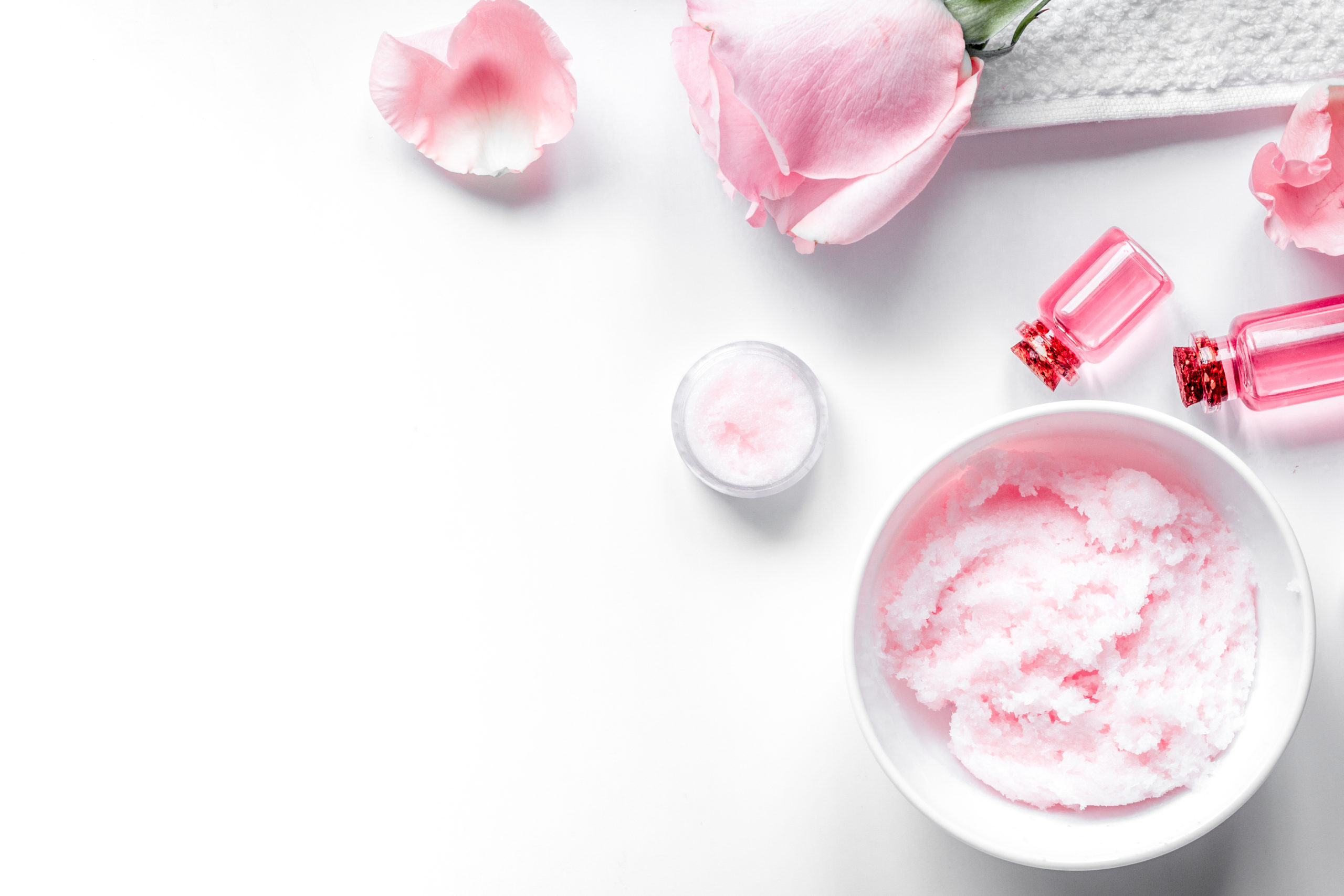 organic cosmetic with rose oil on white background top view.
